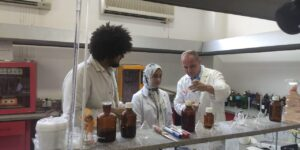 Professor with students in lab